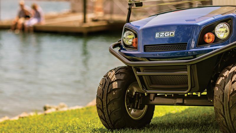 EZGO Express electric golf cart with brush guard and premium golf cart seats.