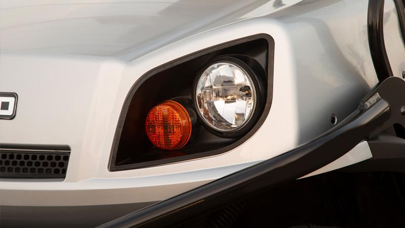 EZGO Express S6 golf cart with premium headlights and brakes lights golf cart accessories.