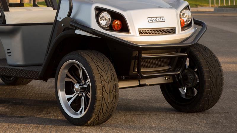 EZGO gas golf cart with a golf cart brush guard and lift kit.