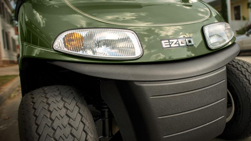 EZGO Freedom RXV fleet golf cart with headlights and brake lights.