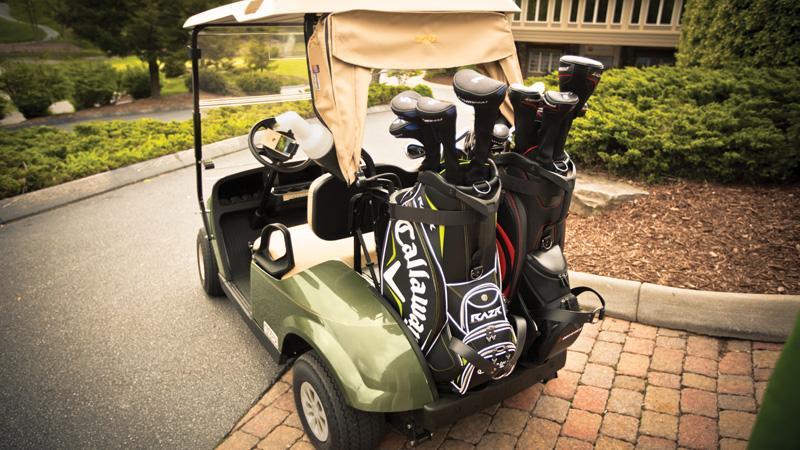 EZGO TXT gas golf cart with golf club bag-well with optimal space for golf clubs.