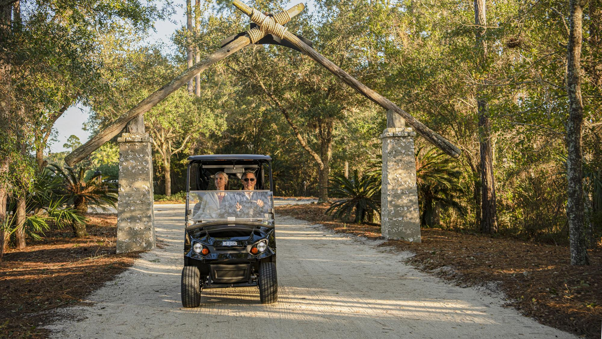 EZGO Express S2 Personal Golf Cart with Top and Windshield Accessories