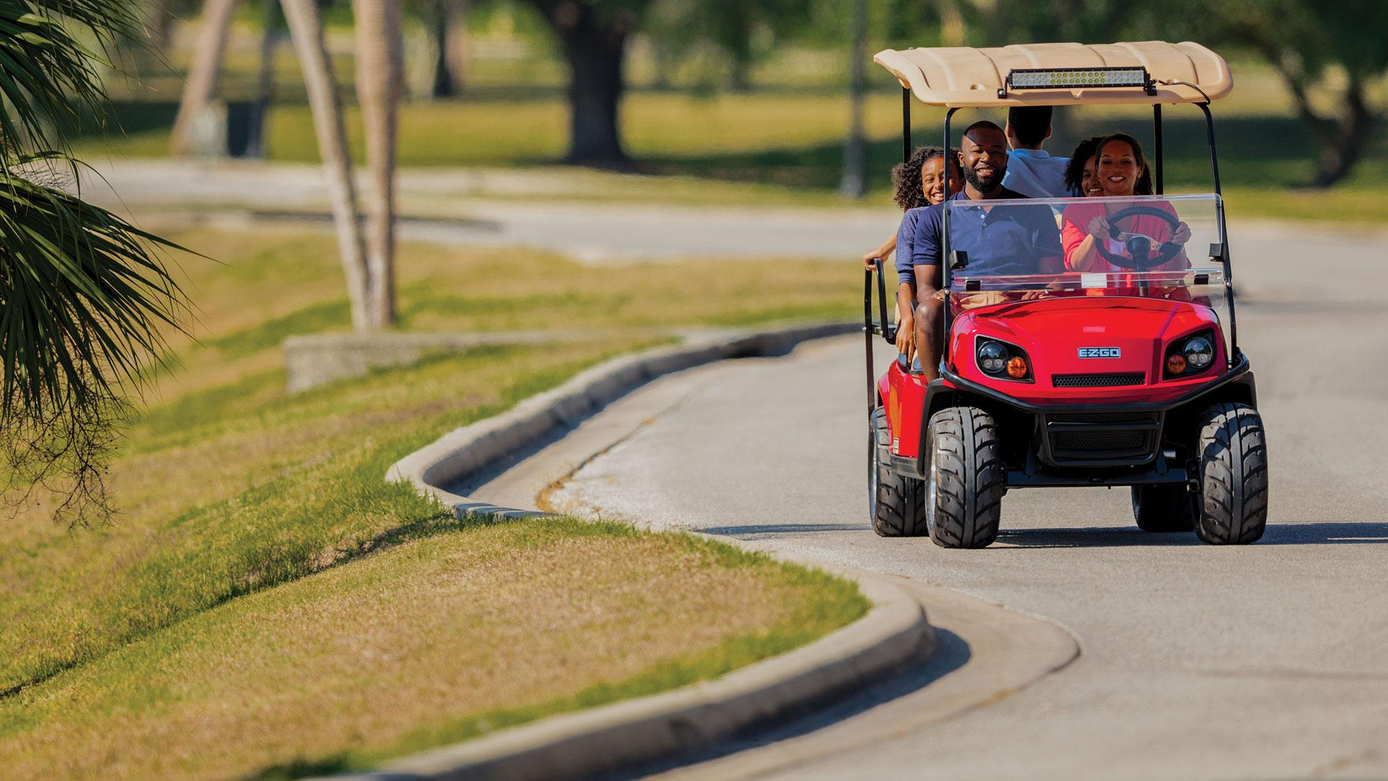 EZGO Express S6 Golf Cart with Top and Light Bar Accessories