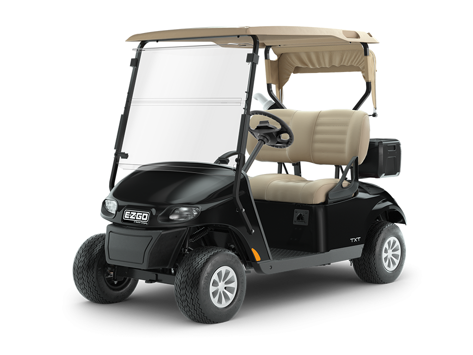 EZGO Freedom TXT ELiTE lithium golf cart with comfortable seats and headlights.